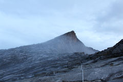 Hikers trekking towards the misty Low's Peak, Mount Kinabalu before sunrise Royalty Free Stock Photography