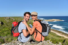 Hikers on trip enjoying the view on islands Stock Photo