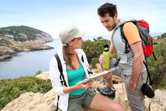 Hikers on a trip searching for the way royalty free stock image
