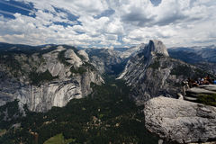 Hikers view Half Dome Mountain clearly in mountain landscape Stock Photos
