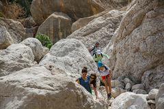 Hikers in Wadi Tiwi Stock Photography