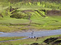 Hikers Wading River in Icelandic Highlands stock photography