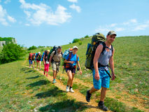 Hikers walk on a path Royalty Free Stock Photo