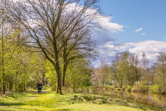 Hikers walking along a river Royalty Free Stock Photography