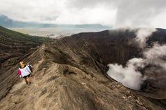 Hikers Walking Around Mount Bromo in Java, Indonesia royalty free stock photos