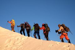 Hikers walking on the ascent Royalty Free Stock Image