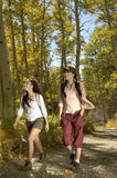 Hikers Walking On Path Through Forest Royalty Free Stock Photography