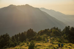 Hikers walking on the Poon Hill and beautiful sunrise sky ,Nepal. royalty free stock images