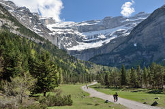Hikers walking to the cirque of Gavarnie Royalty Free Stock Photo