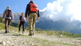 Hikers walking outdoors wearing hiker backpacks. Hikers walking to the Tahtali mountain peak in Turkey, Antalya province wearing hiker backpacks. Tahtali stock footage