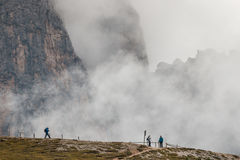 Hikers on walking track in Dolomites Stock Photo