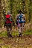 Hikers walking in a trail Royalty Free Stock Images
