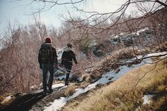 Hikers Walking In Winter stock images