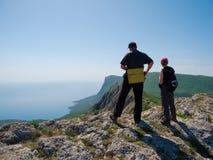 Hikers watch the terrain Stock Photo