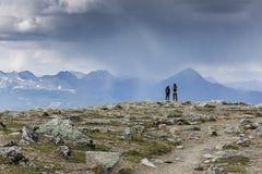 Hikers Watching An Approaching Storm - Jasper National Park, Can Stock Photos