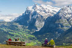 Hikers watching the swiss alps Stock Images