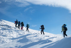 Hikers in a winter mountain,  Ukraine, Karpaty Stock Photos