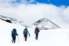 Hikers in winter mountains Stock Photos