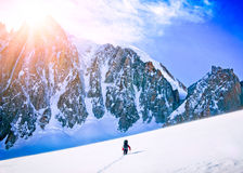 Hikers in winter mountains Stock Images