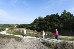 Hikers at the Zuidduinen stock images