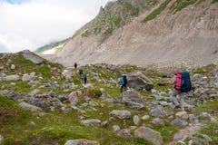 Hikier is climbing mountain in Caucasus Stock Photo