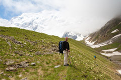 Hikier is climbing mountain in Caucasus Royalty Free Stock Photos
