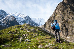 Hikier is climbing mountain in Caucasus Stock Photography