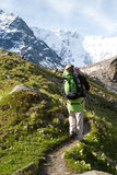 Hikier is climbing mountain in Caucasus Stock Image