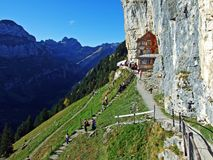 """Hiking and Ã""""scher cliff restaurant Ascher or Aescher cliff restaurant, Berggasthaus Aescher-Wildkirchli or Mountain inn Aescher. Hiking and Ã""""scher cliff royalty free stock image"""