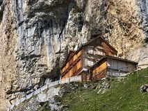 """Hiking and Ã""""scher cliff restaurant Aescher cliff restaurant Berggasthaus Aescher-Wildkirchli or Mountain inn Aescher-Wildkirchli. Hiking and Ã""""scher cliff royalty free stock photo"""