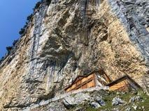"""Hiking and Ã""""scher cliff restaurant Aescher cliff restaurant Berggasthaus Aescher-Wildkirchli or Mountain inn Aescher-Wildkirchli. Hiking and Ã""""scher cliff royalty free stock image"""