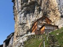 "Hiking and Ã""scher cliff restaurant Aescher cliff restaurant Berggasthaus Aescher-Wildkirchli or Mountain inn Aescher-Wildkirchli. Hiking and Ã""scher cliff royalty free stock images"