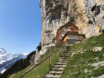 """Hiking and Ã""""scher cliff restaurant Aescher cliff restaurant Berggasthaus Aescher-Wildkirchli or Mountain inn Aescher-Wildkirchli. Hiking and Ã""""scher cliff stock image"""