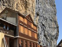 "Hiking and Ã""scher cliff restaurant Aescher cliff restaurant Berggasthaus Aescher-Wildkirchli or Mountain inn Aescher-Wildkirchli. Hiking and Ã""scher cliff stock images"
