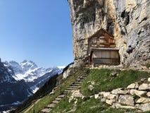 """Hiking and Ã""""scher cliff restaurant Aescher cliff restaurant Berggasthaus Aescher-Wildkirchli or Mountain inn Aescher-Wildkirchli. Hiking and Ã""""scher cliff stock photo"""