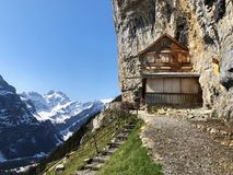 "Hiking and Ã""scher cliff restaurant Aescher cliff restaurant Berggasthaus Aescher-Wildkirchli or Mountain inn Aescher-Wildkirchli. Hiking and Ã""scher cliff stock photography"