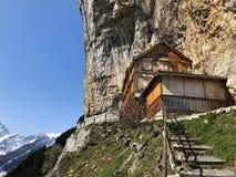 "Hiking and Ã""scher cliff restaurant Aescher cliff restaurant Berggasthaus Aescher-Wildkirchli or Mountain inn Aescher-Wildkirchli. Hiking and Ã""scher cliff royalty free stock photos"