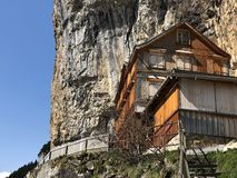 "Hiking and Ã""scher cliff restaurant Aescher cliff restaurant Berggasthaus Aescher-Wildkirchli or Mountain inn Aescher-Wildkirchli. Hiking and Ã""scher cliff stock photos"