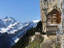 "Hiking and Ã""scher cliff restaurant Aescher cliff restaurant Berggasthaus Aescher-Wildkirchli or Mountain inn Aescher-Wildkirchli. Hiking and Ã""scher cliff royalty free stock photography"