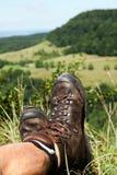 Hiking ботинки имеют пролом Стоковые Фото