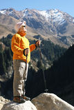 Hiking. Old women in mountain autumn Stock Photography