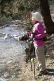 Hiking. Old women in mountain autumn Royalty Free Stock Image