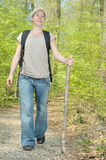 Hiking. Woman hiking in a tranquil forest Royalty Free Stock Images