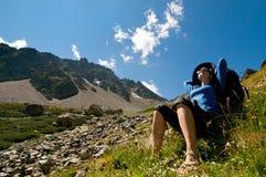 Hiking. Woman hiking in the mountain stock image