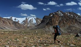Hiking. Hiker with backpack in mountains of Central Asia, Pamir, Tajikistan Stock Photos