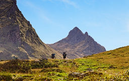 Hiking. Image of two hikers walking in Pyrenees Mountains,France Royalty Free Stock Photography