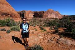 Hiking. Smiling woman hiking near Moab, Utah Royalty Free Stock Image