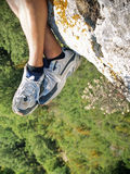 Hiking. Hiker sitting near the cliff's edge Royalty Free Stock Photography