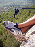 Hiking. Hiker sitting near the cliff's edge Royalty Free Stock Photos