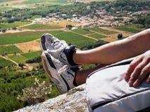 Hiking. Hiker sitting near the cliff's edge Stock Photos